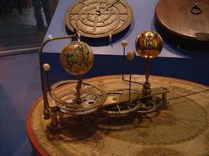 An orrery - a mechanical simulation of part of our solar system.
