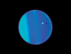 Uranus with Ariel, one of its moons.